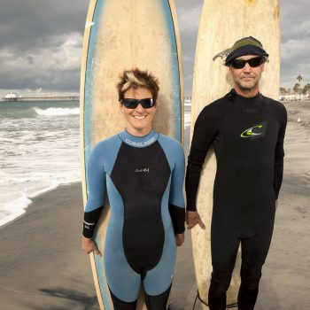 Portrait of surfers, Jenna Close and Jon Held, Oceanside, CA