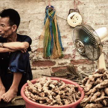 Vendor selling ginger at market in Guangzchou (Canton), China