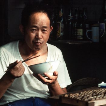 Man eating with chopsticks, Guangzchou (Canton), China