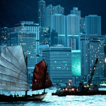 Junk, Hong Kong skyline evening.