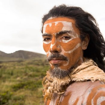 Photography portrait of Rapa Nui man with painted face, Easter Island, Chile