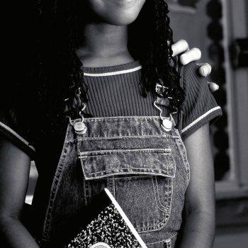 Portrait of African American school girl with notebook. Century Tel. Louisiana
