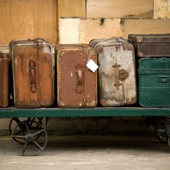 Old suitcases on luggage cart, Pickering, England, UK