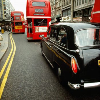 Double decker buses and London taxi, London, England, UK