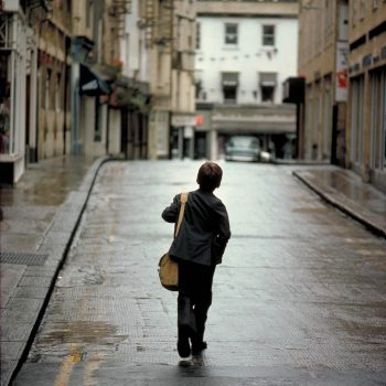 Young school boy from behind, Bath, England, UK