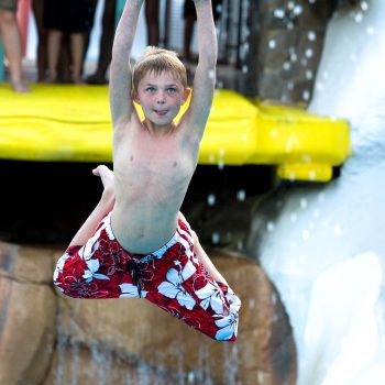 Boy on zip line, Blizzard Beach, Walt Disney World, Orlando, Florida