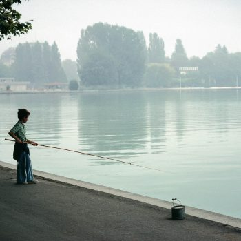 Young boy fishing, Lake Annency, France