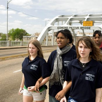 Racially mixed group of students walking across Edmund Pettus Bridge, Selma, AL