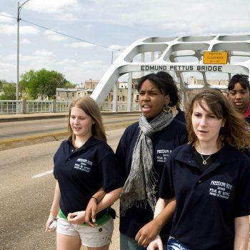 Racially mixed high school students walking across Edmund Pettus Bridge, Selma, AL Kelly/Mooney Photography