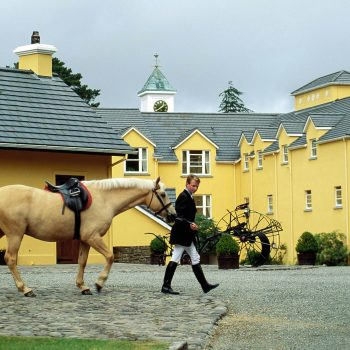 Man walking horse, Sheen Falls Lodge, Ireland