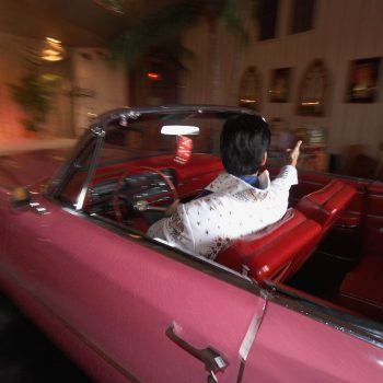 Elvis impersonator driving car into wedding chapel, Las Vegas, Nevada
