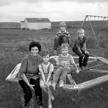 B&W portrait of teacher and school children on playground, Arthur, Nebraska