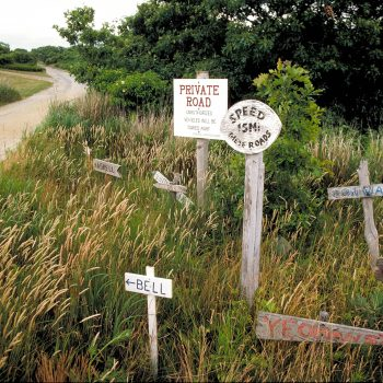 Private no trespassing signs on sandy dirt road, Martha's Vineyard, MA