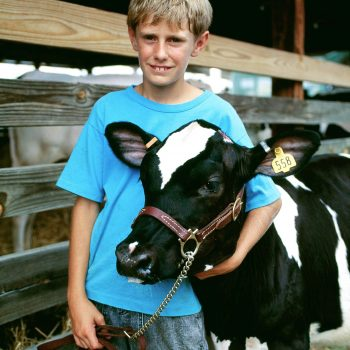 Portrait of boy and cow, Sussex County Fair, New Jersey