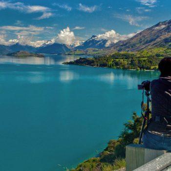 Couple taking photo of lake on South Island, New Zealand