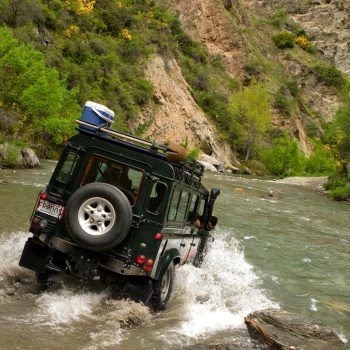 Landrover forging river, South Island, New Zealand