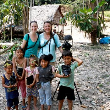 Erin Kelly and Gail Mooney with children in Amazonian village, Peru. Opening Our Eyes Movie