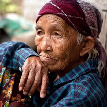 Old woman in Hill tribe village, Thailand. Opening Our Eyes Movie.