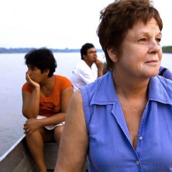 Gina Low of APECA on boat on Amazon River, Peru. Opening Our Eyes Movie.