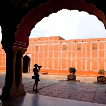 Silhouette of girl taking photo at Red Fort, Jaipur, India. Opening Our Eyes Movie.