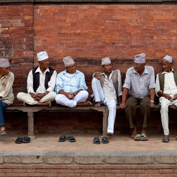 Men on bench, Kathmandu, Nepal. Opening Our Eyes Movie.
