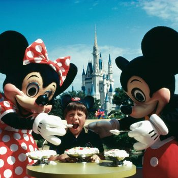 Mickey and Minnie Mouse feeding child ice cream., Walt Disney World, Orlando, Florida