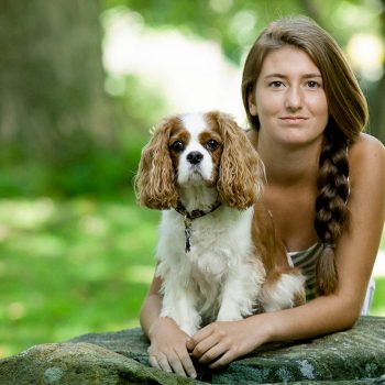 Portrait of young girl and dog.