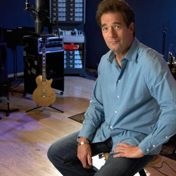 Portrait of Huey Lewis in recording studio.