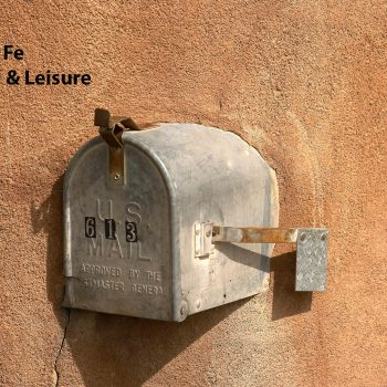 Mailbox in adobe wall, Santa Fe, NM